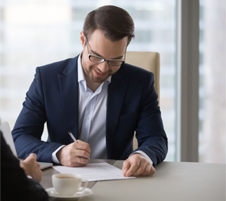 Man signing contract after meeting with colleague